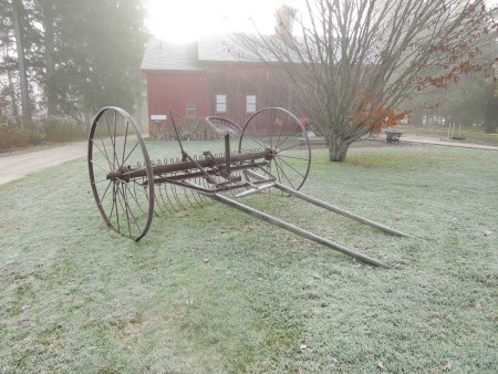 farm equipment by barn fog